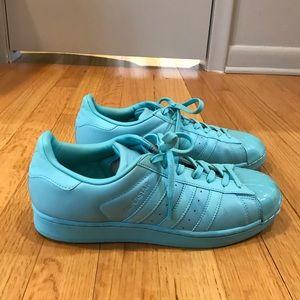 Blue monotone Adidas superstars